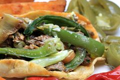 Fajitas - Mexican Food. Fajitas - overhead shot of mexican food steak taco wrap Stock Photos