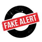 Fake Alert rubber stamp Stock Photos