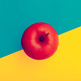 Fake Apple in red paint. minimal style Stock Photo