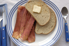 Fake Bacon. Breakfast plate of bread and butter and soy bacon Stock Photo