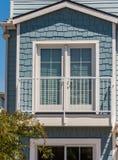 Fake balcony and double full lite door. Pale blue shakes shingle siding fake balcony and double full lite door Stock Photos