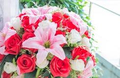 fake beautiful plastic Lillyand rose  flower Royalty Free Stock Photography