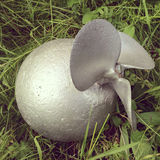 Fake bomb on a grass Stock Photo