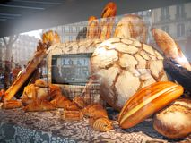 Bread and Pastries Showcase Printemps Haussmann Paris. Fake bread loafs, baguettes, croissants and more as window decoration at the Au Printemps department store stock images