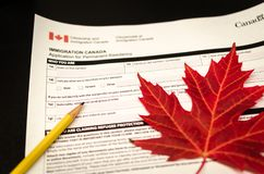 Immigration Canada. A fake Canada immigration form with maple leaf royalty free stock images
