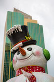 Fake Christmas snowman with city view. Fake Christmas snowman in Panama City, Panama 2014 Royalty Free Stock Image