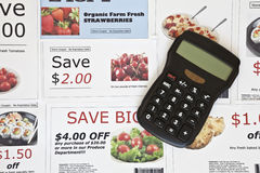Fake Coupons and Calculator Royalty Free Stock Photography