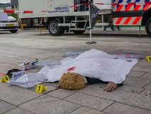Fake crime scene. ALMERE, NETHERLANDS - 12 APRIL 2014: Dummy dead body in a crime scene during an enactment at the first National Security Day held in the city Stock Images