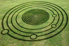Fake Crop Circle in the Meadow. Concentric circles and spiral to make a fake crop circle in the meadow Royalty Free Stock Photo