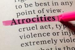Definition of atrocities. Fake Dictionary, Dictionary definition of the word atrocities. including key descriptive words stock photo