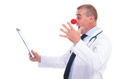 Fake doctor being amazed about the results. That he can't read Royalty Free Stock Image