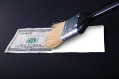 A fake dollar. In a dark background Stock Photography