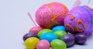 Fake eggs with jelly beans. Colorful jelly beans protect fake multi-colored eggs Stock Photo