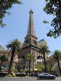 Fake Eiffel tower in Las Vegas. The imitation Eiffel tower on the strip in Las vegas complete with palm trees and traffic Royalty Free Stock Images