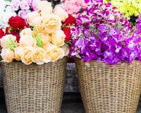 Fake fabric roses in basket Royalty Free Stock Photos