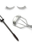 Fake false eyelash with eyelash curler and mascara on white Stock Photo
