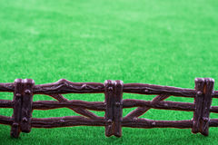 Fake fence over grass Royalty Free Stock Image