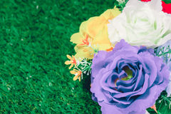 Fake flower vases on a grassy Stock Image