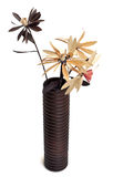 Fake flowers. A cylindrical wooden vase containing artificial flowers Stock Image