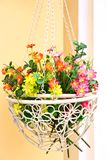 Fake flowers in a basket Royalty Free Stock Photography