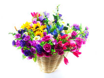 Fake flowers in basket studio shot Stock Photography