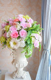 Fake flowers. Colorful fake flowers in a white vase Stock Photo