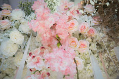 Fake flowers decorate on backdrop. Artificial plants ,fake flowers decorate on backdrop Stock Photography
