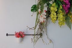 Fake flowers. Decorate on white wall Royalty Free Stock Photos