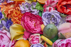 Fake flowers and fruits closeup Royalty Free Stock Images