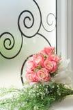 Fake flowers. Fake flowers on glass window Stock Photo