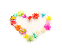 Fake flowers  heart shape ring against white background Stock Photos