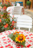 Fake flowers on table in coffee shop Royalty Free Stock Photo