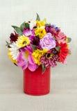 Fake flowers in tin vase Royalty Free Stock Photos