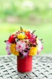 Fake flowers in tin vase Stock Photos
