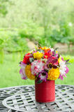 Fake flowers in tin vase Royalty Free Stock Photography