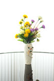 Fake flowers in the vase on wihte background Royalty Free Stock Photos