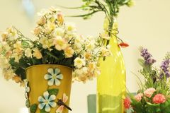 Fake flowers in vases royalty free stock photography