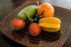 Fake fruit on dish. Fake rambutan , mango , orange and mangostar on dish Royalty Free Stock Images