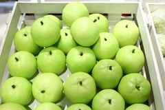 Fake fruits and fruits on shelves Royalty Free Stock Photos