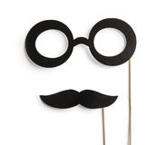 Fake glasses and mustaches on sticks Stock Photo