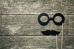 Fake glasses and mustaches on sticks Stock Photos
