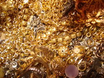 Fake gold chains. A pile of fak gold chains, jewellery and badges royalty free stock image