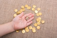 Fake gold coins are around the little crown royalty free stock photo