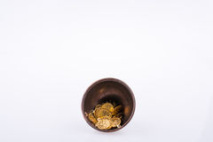 Fake gold coins in a metal plate. Fake gold coins in an old decorative metal plate royalty free stock photos