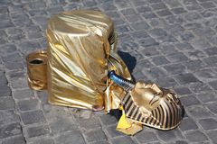 Fake golden mask pharaoh lies on pavement Stock Photos
