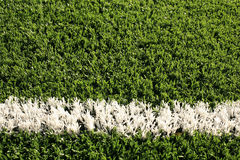 Fake grass soccer field with white line Royalty Free Stock Images