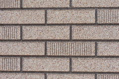 Fake grey brick wall siding Royalty Free Stock Photo
