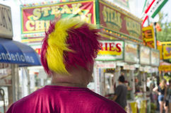 An Iowa State Fair brings out crazy Cyclone Hair. The Iowa State Fair is always an interesting place.  A man walks around with a cyclone wig Stock Image