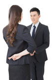 Fake hand shake. Business women and men shake hands and put finger cross on back, closeup portrait isolated on white background Stock Photography