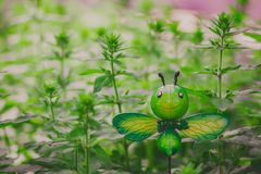 Fake insect in the garden, funny butterfly model royalty free stock images